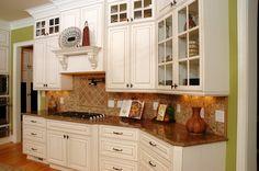Mosaic backsplash, white cabinets