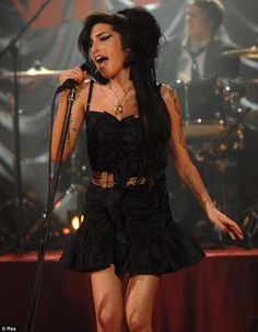 Amy Winehouse...definitely not my ideal role model...but loved her style and her soulful voice.
