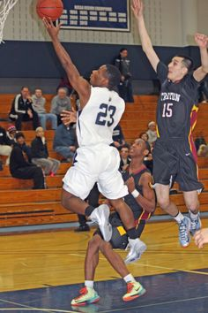Jeffrey Cole soars to the hoop for the lay in against Triton College.
