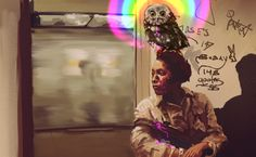 Owl as a companion animal in dangerous NYC subway in 70's. (It has been puking rainbow to repel attackers).