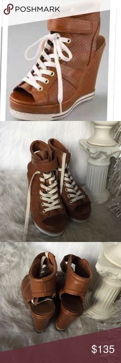 Ash Wedge Sneakers Open toe and open heel. Lace up platforms. Worn many times, but still in excellent shape. Honey Caramel color. Ash Shoes Wedges