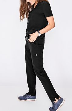 Yola Skinny Black Scrubs Polish your professional look with our most stylin' scrub pant yet. A tapered, skinny fit offers a contoured silhouette, equipped with our sign Scrubs Outfit, Scrubs Uniform, Professional Outfits, Professional Look, Stylish Scrubs, Cute Scrubs, Black Scrubs, Scrub Pants, Scrub Shoes