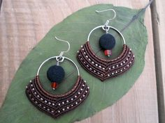 Micro macrame earrings with handmade hoops , tiny metal beads ,natural Carnelian and Lava . Made of very strong ,high quality waxed thread in dark Brown color . The ear hooks are made of stamped 925 sterling silver ,the hoops are handmade of white metal . The hoops measures 3.3 cm ( 1.29 inches ) The length of the earrings is 6.5 cm ( 2.55 inches ) One of a kind creation, designed and created by Selinofos Art .