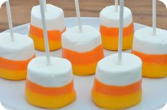 Candy Corn Marshmellow  Put marshmellows on sticks. Melt a bowl of orange and yellow chocolate. Dip them first in orange to the height you want. Once dry dip in yellow not as high. Enjoy!