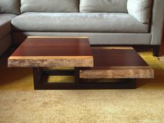 The live edge and clean lines of this two-tiered coffee table introduce a natural element into the modern home. Shown with live-edge padauk top.