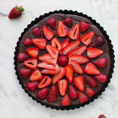 Easy and delicious. Fudge like chocolate ganache and strawberries in a cookie crumb crust.