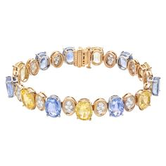 """Estate Oscar Heyman Multicolored Sapphire & Pavé Diamond Link Bracelet, designed with alternating oval-shaped blue and yellow sapphires separated by oval-shaped pavé diamond sections, mounted in 18k yellow gold and platinum, numbered 800852, signed Oscar Heyman Brothers. 7"""" length /17,500"""