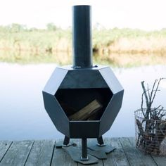 """A sharp, geometric shape sets this patio chiminea apart from the crowd, each one crafted from raw, hand-welded steel. The heavy-gauge metal responds to the elements by developing a reactive patina or rust as a protective barrier, self-sealing over time to beautifully preserve its integrity.- Steel- Removable chimney for cleaning- Will rust when exposed to elements during outdoor use- Handmade in the USA44""""H, 24"""" diameter"""