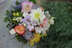 Wedding Bouquet of Dahlias, Roses, Purple Thistle, Ranunculus, Freesia, and Succulents