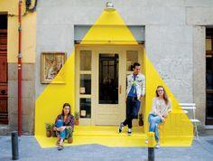 (fos) team paints light onto a grey street - Barcelona Spain