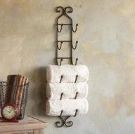 A wine rack as towel storage in the bathroom!  Amazing idea!
