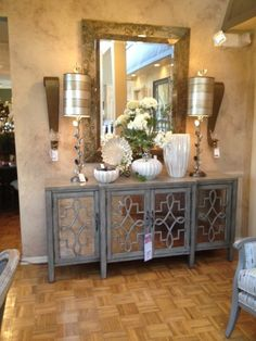 This distressed gray wood buffet is beautiful and the fretwork on the doors is very in for 2013