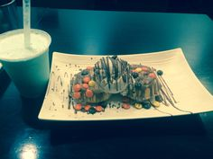 This is a peanut butter and vanilla ice cream dessert on top of waffles and a side of a bubblegum milkshake!!!