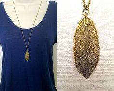 Necklace details:  • Pendant is antique bronze-colored leaf made of zinc alloy metal • Pendant is 2 in height and 0.5 in width • Chain is antique brass tiny flat soldered cable chain 2x1.4mm • Necklace is 30 with 2 extender chain and lobster clasp closure • Lead safe, nickel safe • Base metal of chain is brass  Other information:  • Every purchase from our shop supports nature-related organizations • This necklace is part of our Into the Woods collection, and supports rainforest conservation…