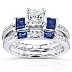 Blue Sapphire and Diamond Bridal Ring Set 1 1/4 Carat (ctw) in 14k White Gold. 1/2 Carat Princess Cut Center Diamond. Set features a blue sapphire and diamond engagement ring with a matching blue sapphire and diamond band. All stones are natural. Manufactured by Kobelli. Complimentary jewelry gift box included.