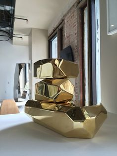 """""""Microrocksbrass,"""" a mirror-polished brass sculpture by Arik Levy. It's one of the pieces at Please Do Not Enter, a carefully curated design boutique for sophisticated men in downtown L.A."""