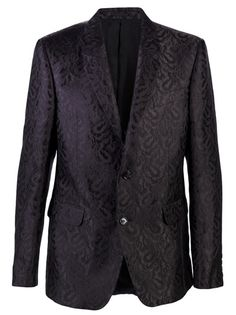 Printed classic blazer in black from Alexander McQueen. This two-button blazer features an allover textured print, one chest pocket, two front pockets, and two interior pockets.