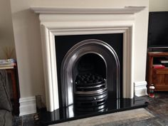 Limestone fireplace with arch cast