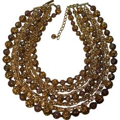 This is a Gorgeous, Showy, Multi-strand Vintage West German Necklace. It has Iridized Carnival Glass Type Beads that shine in Purple, Green, and Blue