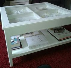 We both love this LIATORP coffee table from IKEA, with the pull-out drawer.  Looks like it only comes in white though, so we'll want to paint/stain it darker,