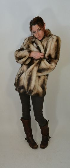 """Beautiful Fitch Fur Coat, looks amazing on, wonderful coloring, fits like a medium or large, but looks great just as an oversized 80s fur coat. Amazingly warm and in excellent condition, has pockets on each side. Tag says """"the evans collection"""" All measurements taken while garment is laying flat.  shoulders 17  armpit to armpit 21 inches (42 around)  sleeves 23 inches  waist 23 inches (46 around)  nape to hem 31 inches 