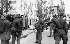 Italian men are rounded up by German and Fascist Italian soldiers in front of the Palazzo Barberini in reprisal for the partisan attack on the SS Police Regiment Bozen on the narrow street of Via Rasella on 13 March 1944 which killed twenty-eight SS...