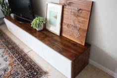 Stained-DIY-media-cabinet using IKEA unit and stained wood panels