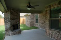 Outdoor living, Outdoor fireplace, huge back porch  #mcbeehomes #newhomeconstruction #outdoorliving