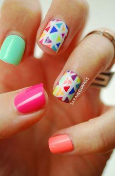 If you're a fan of pastel colors, then this abstract nail art design is perfect for you. Painted in a uniform colored pattern divided by thick lines of white nail polish.