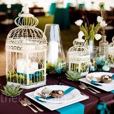 wedding centerpiece, bird cage, green, purple, blue, white candles