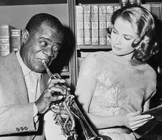 """Grace Kelly and Louis Armstrong on the set of """"High Society"""" 1956"""
