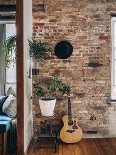 brick wall in a tiny, stylish apartment