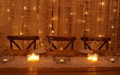 Vintage lace backdrop with pealight cascade, lace table runner, terrarium lanterns, rustic trestle table and crossback chairs for a rustic barn wedding at Upwaltham Barns by www.stressfreehire.com #venuetransformers