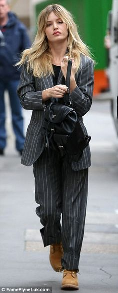 Making her entrance: Jerry's 23-year-old daughter Georgia May Jagger was dressed in a pinstripe suit