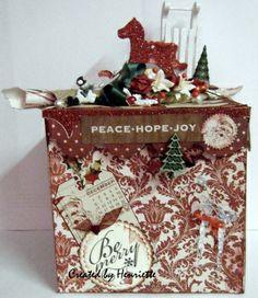 """Kerstdoos gemaakt van een idee van de Sol die Ettie heeft gegeven bij """"Kaarten maken bij Tiets"""". ik heb uren nagedacht hoe ik het moest doen en ineens wist ik hem groter te maken naar 15 x 15 cm..."""