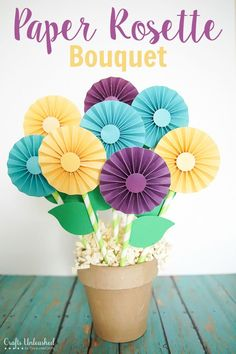 Paper Bouquet: DIY Rosette Gift - Crafts Unleashed This adorable rosette flower gift idea is perfect for a customized, do it yourself, mother's day gift! It is easy and in. Diy Mother's Day Bouquet, Paper Bouquet Diy, Diy Paper, Paper Crafts, Diy And Crafts, Crafts For Kids, Mothers Day Crafts, Living At Home, Flower Crafts