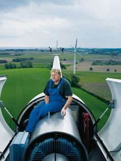 Farmer Jorgen Tranberg sitting astride the wind turbine he has erected on his own land. Photo Credit: Nicky Bonne