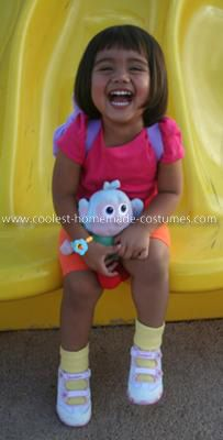 Homemade Dora Costume: My daughter LOVES Dora the Explorer so I knew that I had to start looking for costumes. Sadly I did not like any of the ones sold in stores/online so I