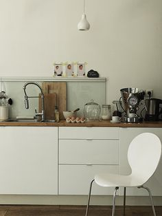modern cabinets with wood counter