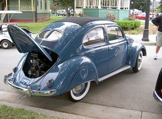 1953 split window rag top bug. Grew up in a similar car. I would ride in the back compartment. Back in the day (80's) in California when it was legal to just throw your kid in the back of the car.