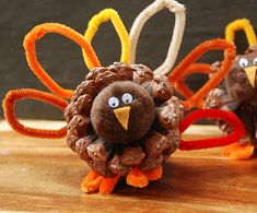 This would be fun for kids to make. I saw one that they stuck each persons name on a paper in the turkey feathers. Would be fun for everyone to have one by their plate I think!