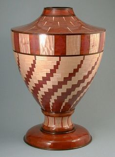 "Segmented turned vessel made from Wenge, bloodwood, bubinga, curly maple, purpleheart, ash, quilted maple. 26""H x 18""D, Waterlox finish"