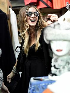 The Carrie Bradshaw smile! Sarah Jessica Parker went shopping for vintage goodies in Rome, Italy's Via Sannio market.