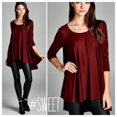 """LOOSE FIT HIGH LOW SWING TOP This cute swing top has three-quarter length sleeves, loose fit, round neck and high low design. Made with lightweight knit fabric that is soft, drapes well and has good stretch. 61% polyester, 33% rayon, 8% spandex. Made in USA ♦️SMALL: bust 44""""♦️LARGE: bust 46"""" PLEASE DO NOT BUY THIS LISTING, I will personalize one for you. tla2 Tops"""