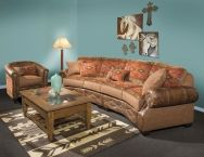 """Jackson Theater Grouping Dimensions: Theater Sofa:  132""""L x 47""""D x 40""""H Barrel Chair:  31""""L x 33""""D x 35""""H Jumbo Ottoman:  47""""L x 25""""D x 18""""H    The Jackson Theatre sofa Grouping is absolutely fabulous for your Western room décor.  The fabric is a rich rusty firebrick red with turquoise accents all woven with browns and earth tones in the Native American design.  This sofa would go well with this distressed leather as shown or with a chocolate distressed as well."""