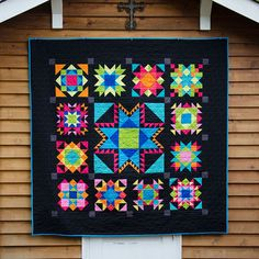 Last Quilt Standing by Anita of Bloomin' Workshop. Pattern is Grandmother's Sampler by Lori Smith and worked as a Quilt shop BOM.