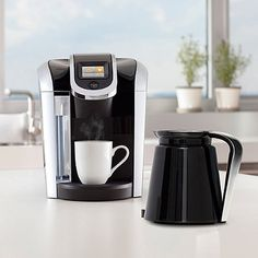 Featuring revolutionary Keurig 2.0 Brewing Technology™, the K450 brewer is designed to read the lid of each K-Cup® or K-Carafe™ pack and boasts convenient one-touch operation to perfectly brew a single-serve cup or a 4-cup carafe.