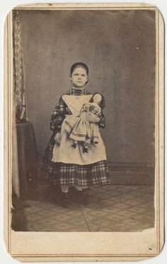 Young Girl Holding Doll, Ohio, 1863. civil war era fashion apron