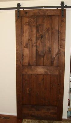 pacific entries 36 in x 84 in rustic 2panel vgroove unfinished knotty alder wood interior barn door with bronze hardware