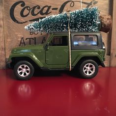 Green Jeep Wrangler Carrying Christmas Tree Ornament by juniperjade on Etsy https://www.etsy.com/listing/258651419/green-jeep-wrangler-carrying-christmas